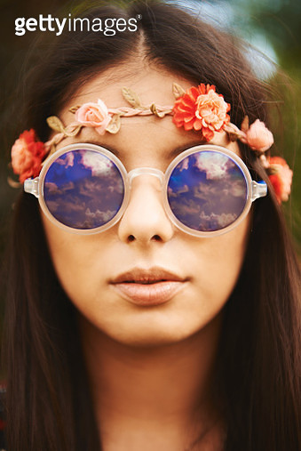 Portrait of young hippy woman in floral headband and sunglasses at festival - gettyimageskorea