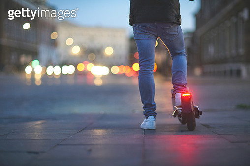 Man using electric push scooter - gettyimageskorea