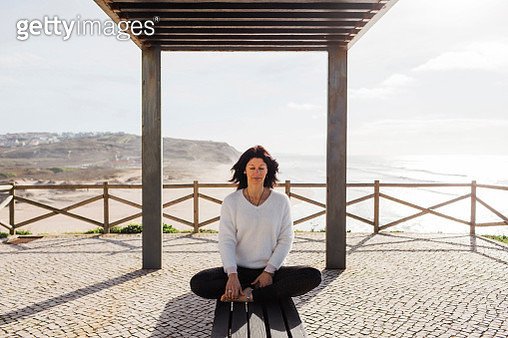 Woman meditating outdoors, Lisbon, Portugal - gettyimageskorea