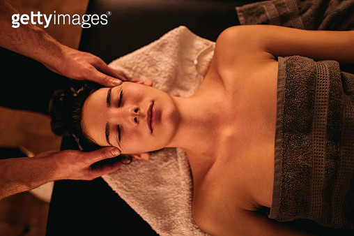Young woman getting head massage - gettyimageskorea