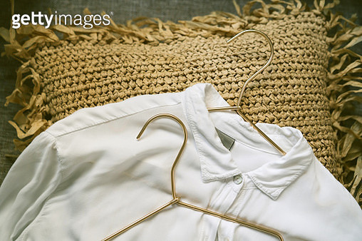 Metallic golden hangers and white shirts - gettyimageskorea