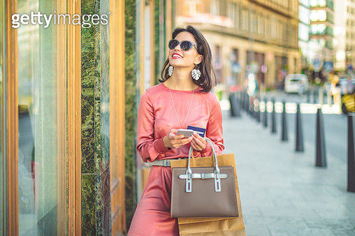 Young woman is ordering goods on her mobile - gettyimageskorea