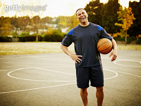 Mature basketball player standing on outdoor court - gettyimageskorea