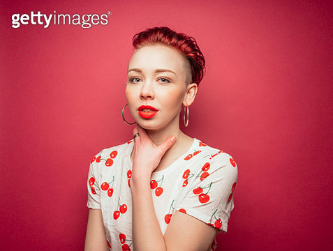 Punk model in cherry shirt on red background - gettyimageskorea