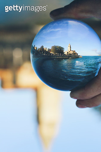 Gijón, Asturias, Spain - October 25, 2019: Church on San Pedro through a crystal ball, in the beach of San Lorenzo, city of Gijón, Principality of Asturias, north of Spain. - gettyimageskorea