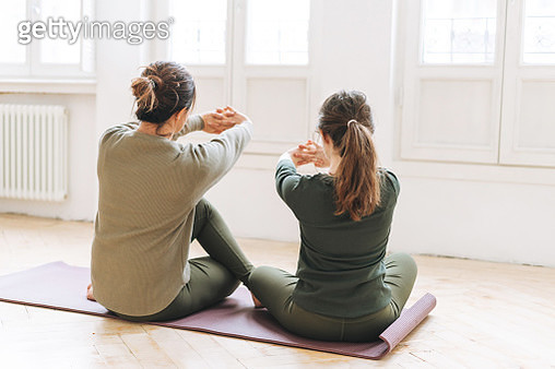 Attractive Mother Middle Age Woman And Daughter Teenager Ptactice Yoga Together In The Bright Studio - gettyimageskorea