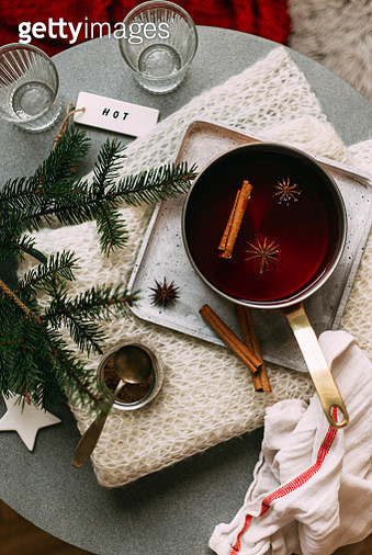Non-alcoholic mulled wine with lemon and cinnamon in glass, flat lay - gettyimageskorea