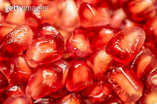 Peeled pomegranate seeds, abstract red background - gettyimageskorea