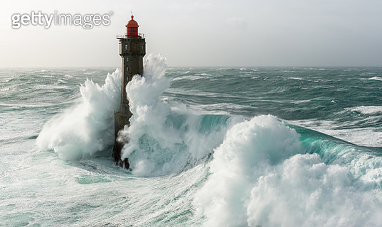 This image was taken during winter 2016 when the Storm Ruzica arrived on the west coast of France. The waves were more than 15m high. We can see a beautiful lighthouse striked by a huge wave. It was in Ouessant, Jument lighthouse. - gettyimageskorea