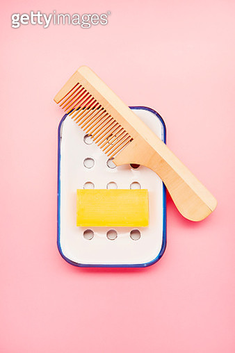 Still life of hair soap, enamel soap dish and wooden comb on pink background - gettyimageskorea