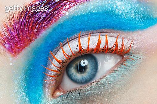 Close-up studio shot of woman eye. - gettyimageskorea