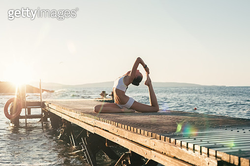 Girl practicing yoga - gettyimageskorea