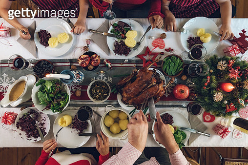 family dining at christmas table - gettyimageskorea