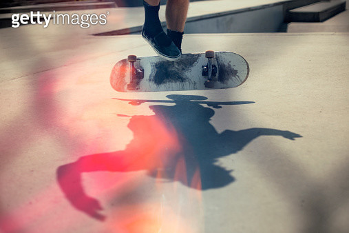 Skateboarder doing an Ollie - gettyimageskorea