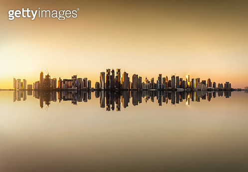 Reflection Of Buildings In River Against Sky During Sunset - gettyimageskorea