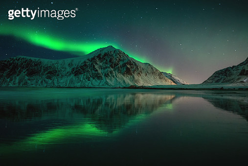 Northern lights and mountain reflection - gettyimageskorea