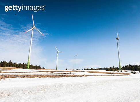 Wind turbines in snowy landscape - gettyimageskorea