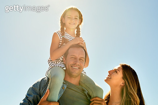 Shot of an adorable little girl having a fun day outdoors with her mother and father - gettyimageskorea