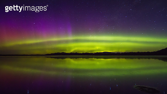 Colourful double arc aurora display with reflection - gettyimageskorea