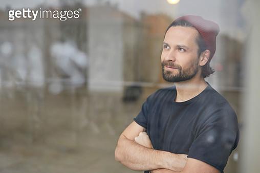 Portrait of an artist in his atelier looking out of wondow - gettyimageskorea