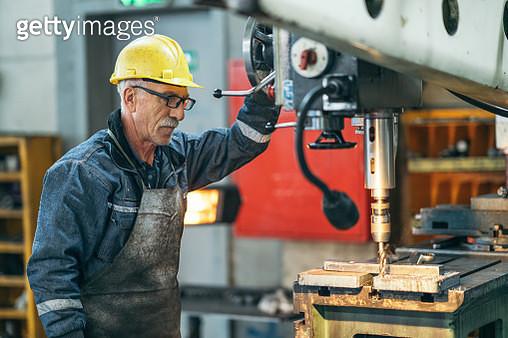Turner worker working on drill bit in a workshop - gettyimageskorea
