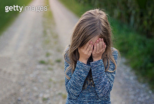 Girl covering face - gettyimageskorea