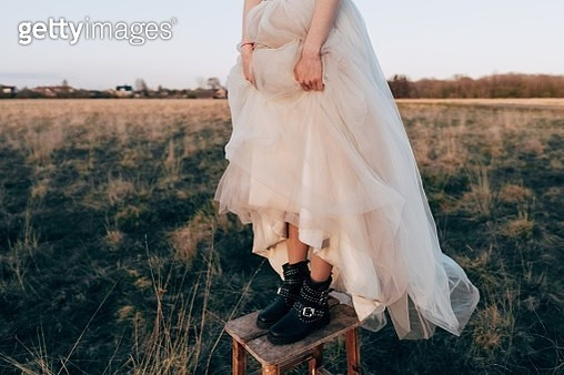 Low Section Of Woman Standing On Stool Over Field - gettyimageskorea