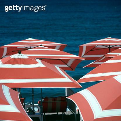 Beach umbrellas in Nice, France - gettyimageskorea