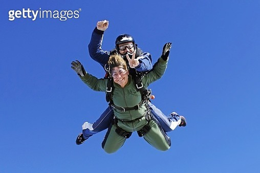An old lady practicing skydiving - gettyimageskorea