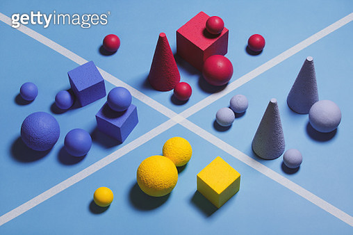 Abstract multi-colored objects on blue background - gettyimageskorea