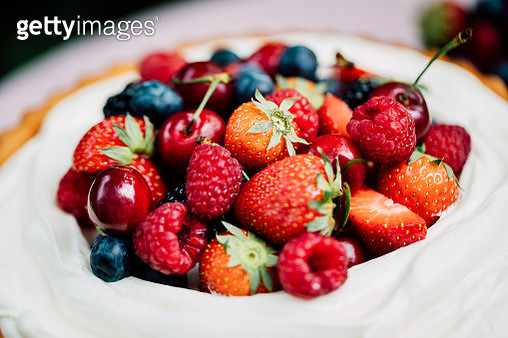Close-up of a fresh homemade fruit cake on a table. Delicious cheesecake with berries. - gettyimageskorea