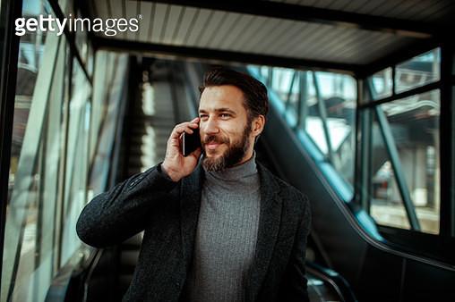 Businessman talking on his Phone - gettyimageskorea