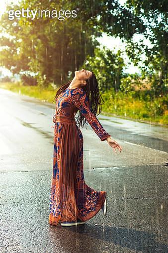 Woman dancing in the rain - gettyimageskorea