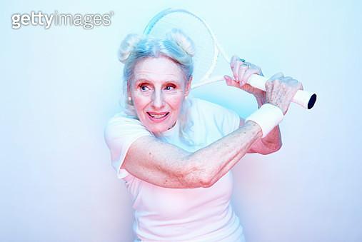older woman with tennis racket - gettyimageskorea