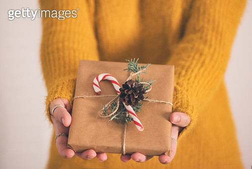Close up of a woman holding gifts - gettyimageskorea