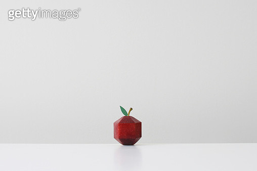 Red apple crafted into geometric shape imitating paper origami - gettyimageskorea