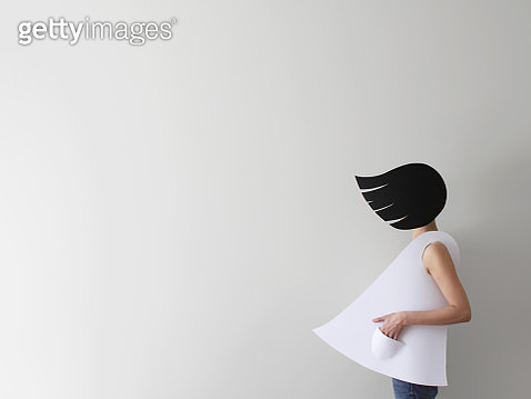 Conceptual woman wearing paper clothes and hair in wind - gettyimageskorea