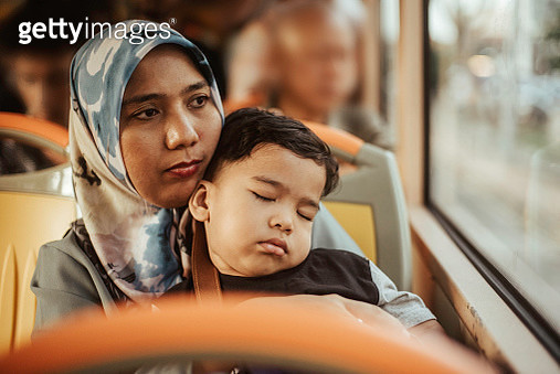 Mother and Toddler Son in a Bus - gettyimageskorea