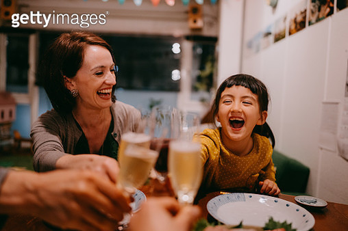 Family toasting at dinner - gettyimageskorea