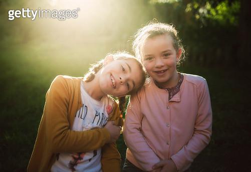 Portrait of two little girls at backlight - gettyimageskorea
