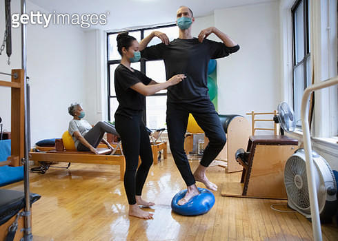 people doing exercise At rehab center wearing mask - gettyimageskorea