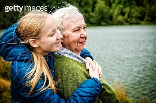Close-Up Of Woman Embracing Grandmother - gettyimageskorea