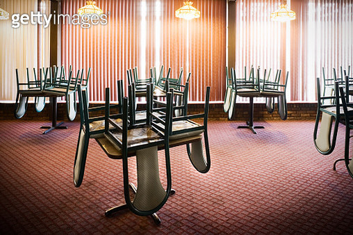 Chairs Stacked on Tables in an Empty Restaurant - gettyimageskorea