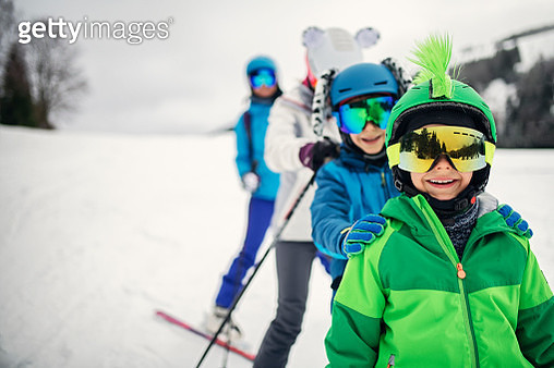 Mother with kids are enjoying skiing on a winter day. Sunny winter day. Nikon D850 - gettyimageskorea