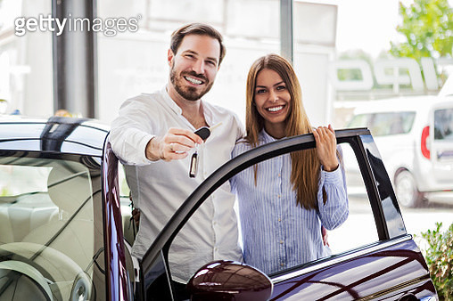 Young couple buying first car - gettyimageskorea