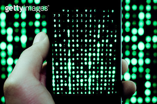 Cropped Hand Photographing Computer Language With Mobile Phone - gettyimageskorea