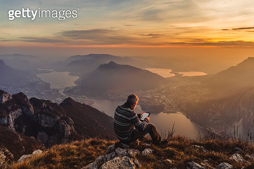 Man hiker solo on the mountain during golden hour - gettyimageskorea