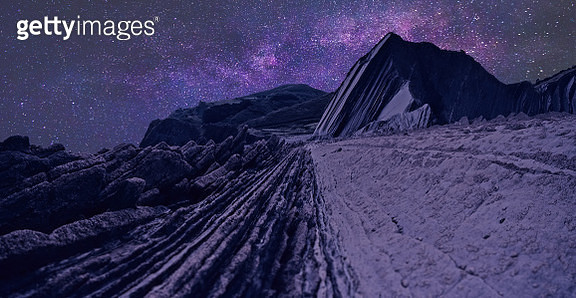 Scenic View Of Rock Formation Against Sky At Night - gettyimageskorea