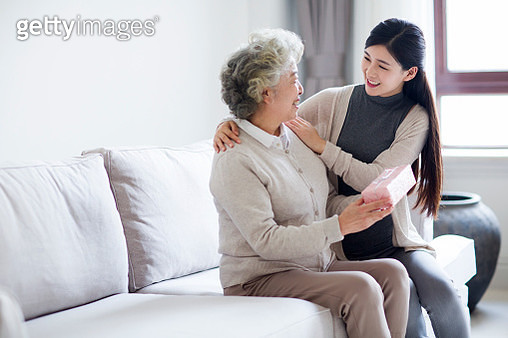 Happy mother and daughter with gift box - gettyimageskorea