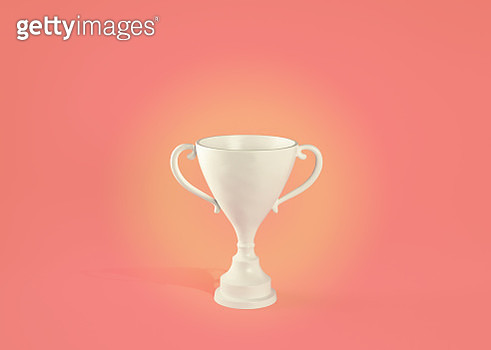 white loving cup trophy on a pink/peach background with shadow. - gettyimageskorea